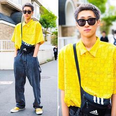 19-year-old @S.o.m.e.n.o on the street in Harajuku wearing a resale button up shirt and baggy denim with Converse sneakers, an Adidas bag, and Guess accessories.