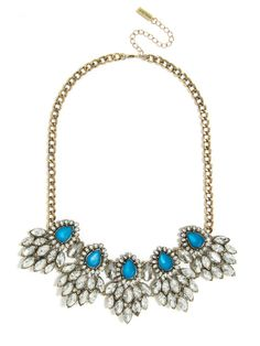Peacock blue teardrops are the focus of this sparkling statement necklace affixed with tons of clear crystal marquise stones in a three-dimensional silhouette.