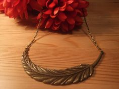 Large Antique Gold Feather Necklace with 15 inch Antique Bronze cable link chain. $15.00, via Etsy.