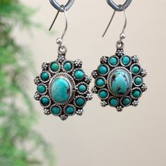 Beautiful In Blue<br />The earrings showcase 15 carats of turquoise in engraved designs on oxidized metal.  Turquoise is related to '' earth-grounding'' and associated with throat chakra as well as heart chakra<br /> [$59.00]