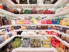 Jenner's handbag closet features white lacquer shelving.