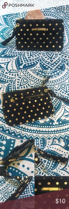 """Juicy Couture Polka Dot Wristlet This little Wristlet has been well-loved; price reflects condition. It has wear in various places all over. The inside is somewhat dingy. There is a decorative piece on the handle that is beginning to split (pictured); it could probably be glued back together with fabric glue. Despite all of this, it is still a useable piece. Length: 9"""" Width: 1/2"""" Height: 6"""" Strap: 5"""" Juicy Couture Bags Clutches & Wristlets"""
