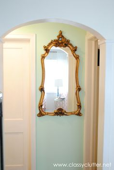 Mint Hallway with gorgeous gold mirror! www.classyclutter.net