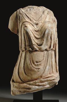 A ROMAN MARBLE DRAPED FEMALE TORSO CIRCA 1ST-2ND CENTURY A.D.