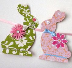 """I left my Christmas tree up this year, lights, but not ornaments, figuring to have a """"Seasonal"""" tree. For Easter, I made garland using this pattern and embellished the rabbits as shown here.  I also made garland with Easter eggs.  For Spring, I used Butterflies and Birds, all made from scrapbooking papers. So cute!"""