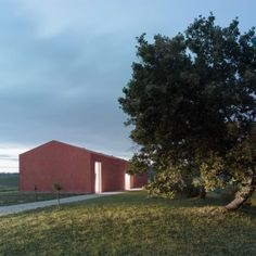 Studio Zero85's hilltop house and studio for  an artist is covered in ridged terracotta tiles