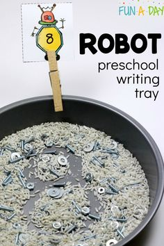 This robot-themed sensory tray is perfect for preschool writing practice! Use it to help form numbers, letters, and more - it's open-ended with limitless possibilities! Includes a free printable for robot number cards. Preschool Writing, Preschool Lesson Plans, Preschool Science, Preschool Printables, Kids Writing, Preschool Learning, Free Preschool, Preschool Crafts, Sensory Activities For Preschoolers