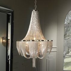 Empire Silver Chain Chandelier shown here composed of thin metal chains in polished nickel finish. Takes 10 bulbs. This chandelier is part of a larger collection of luxury lighting including wall and ceiling lamps and various chandeliers in different sizes.