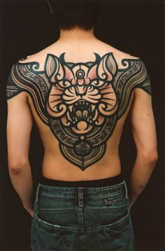 Really NICE black ink line and shade back piece. This is one of the nicer pieces I've seen. Wish I had the artist and shop to post.