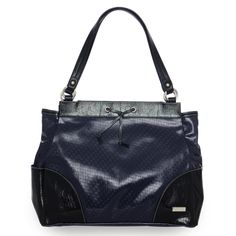 "*Miche Canada* Available through your local Miche Home Party Representative. You may not be heading out to sea soon, but you'll definitely feel like you're at the helm and in control of your day when you carry the Navy-inspired Janice Shell for Prima Bags on your arm. Delightful high-gloss navy blue faux leather in an embossed woven pattern is topped off with black detailing, white stitching and a chic knotted tie. Be sure to check out the chic ""elbow patch"" detailing on the bottom corners."