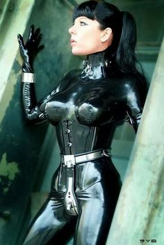 Gorgeous latex catsuit. Chastity belt. Steel cuffs.