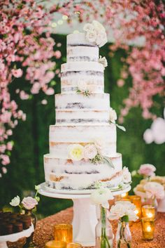 Naked Tiered Cake With Flowers | Onelove Photography https://www.theknot.com/marketplace/onelove-photography-danville-ca-223204 | Kat Keane Weddings | The Little Branch | Super Fine Bakery | Scinema Weddings