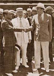 Nucky Johnson (right - played by Steve Buscemi as Nucky Thompson in Boardwalk Empire) shaking hands with boxer Henry Armstrong on the Atlantic City Boardwalk