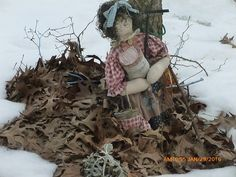 The Seed Lady watching over the winter garden.  Rag doll with can of seeds  . artfromperry