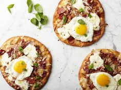 These personal pizzas get a breakfast spin with toppings like bacon, cheese and a fried egg.