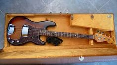 1962 Fender Precision Bass (3-tone sunburst) with ashtray pickup covers attached.