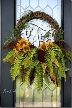 Pretty fall wreath - sunflowers, ferns, colored ferns. Love all the floral at the bottom of wreath! From Back Porch Musings