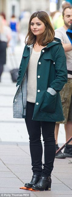 On your mark: Jenna patiently waited for a scene to begin as she sported a moss green coat