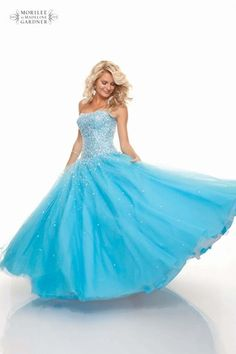 Full skirted ball gown with a strapless beaded bodice, by Mori Lee.
