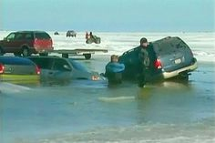A makeshift carpark has turned into a car graveyard after thin ice gave way. Three dozen vehicles have fallen through the ice at a fishing tournament in Wisconsin, US ...