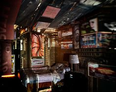 Camera Obscura artist Abelardo Morell. This photograph is a picture of a camera obscura image of Times Square projected onto a hotel room interior.