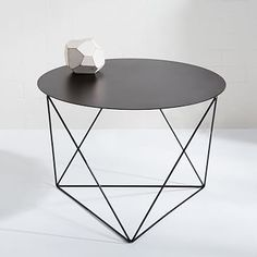 Eric Trine Octahedron Side Table too pricey for its type ($300); won't match a beige sofa; doesn't look high end; spend on bed + sofa and try for inexpensive side tables & lamps