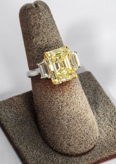 Rare Emerald Cut Fancy Light Yellow VS1 GIA   From a unique collection of vintage engagement rings at https://www.1stdibs.com/jewelry/rings/engagement-rings/