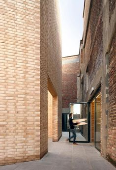 former textile factory in Kortrijk that Belgian studio 51N4E has converted into an arts centre