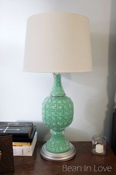 Glass lamp makeover. Love how the brass was spray painted but I dont know if I could bring myself to paint the glass part