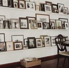 photo gallery wall in hallway... Love this!  Need some old pics, or make them sepia tone.