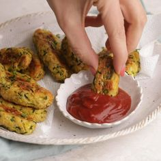 Zucchini Tater Tots Video <br> Zucchini Tots are a low-carb alternative to classic tater tots made with potatoes. Baked in the oven, they're cheesy, tender and perfect for light snacking! Healthy Food Recipes, Healthy Recipe Videos, Healthy Baking, Healthy Snacks, Snack Recipes, Cooking Recipes, Potato Recipes, Baked Zucchini Recipes Healthy, Recipes Dinner