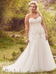 Maggie Sottero - LADONNA, Elegant and sophisticated, this A-line plus size wedding dress combines a decadent, Swarovski crystal beaded lace bodice with an ethereal Chic organza and tulle skirt, perfect for the truly romantic bride. Finished with sweetheart neckline and corset closure. Detachable beaded lace cap-sleeves sold separately.