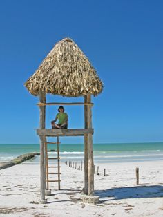 Claim a grass hut and call the beach your own.