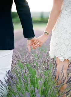 22 Cute Engagement Announcement Ideas You'll Want to Copy - Trust us—you won't want to spill the beans until you've seen these cute and creative engagement announcement ideas. lavender field engaged photo holding hands outdoor flowers {Jose Villa Photography}