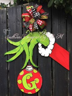 How cute is this Grinch door hanger?!?! He is perfect to hang during The Christmas holidays! It is sure to catch everyones eye and your door