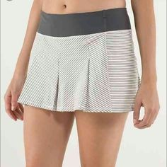Lululemon Fast Cat Pleated Skirt Lululemon 'Fast Cat' Skort. Quick drying and moisture-wicking fabric with Luxtreme waistband and shorts. Attached shorts have silicone gripper at bottom hem so they remain invisible and stay in place. Alternating light-reflective stripes. Two stash pockets in front waistband and back zip up pocket.. Size 6. Excellent used condition! lululemon athletica Skirts Mini