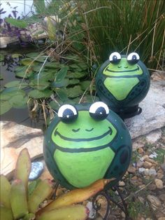 Frogs were made with bowling balls and golf balls were used for the eyes,  My daughter and I made them together.