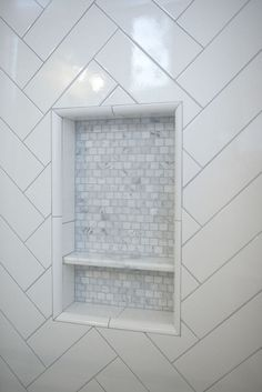 Subway Tile Shower Design To Beautify Your Bathroom Area Shower niche. The shower niche features marble mosaic tile. Tile Shower Niche, Subway Tile Showers, Bathroom Niche, Laundry In Bathroom, Bathroom Ideas, Condo Bathroom, Rental Bathroom, Bathroom Remodeling, White Tile Shower