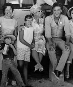 Elvis sits with fans while on the movie set of Follow That Dream 1962.