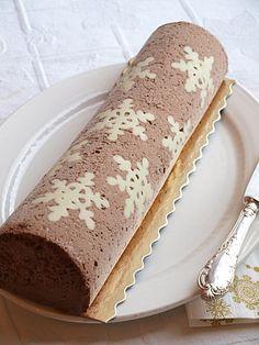 Bûche de Noël Glacée Chocolat pistache décor Chocolat blanc.