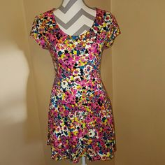 Multi-colored Floral Sun Dress Used less than a handful of times. Super Cute and light. Perfect for Spring or Summer. Total length 30 inches. No Boundaries Dresses