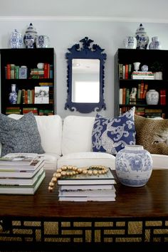 A Thrifted Find: Federal Eagle Mirror  (navy blue, black bookcases, living room, white slipcovered sofas, blue and white jars)