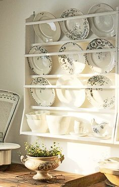 If I can convince my mom to finally pass on her fancy plates we should build a display like this for them. We could swap them for our Christmas plates we've made at Christmas too Plate Racks In Kitchen, Plate Rack Wall, Diy Plate Rack, Plate Shelves, Kitchen Redo, Plates On Wall, Kitchen Remodel, Plate Hangers, Vintage Plates