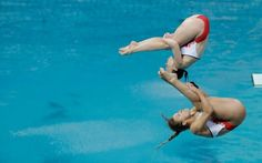 AP PHOTO  Britain's Alicia Blagg, bottom, and Rebecca Gallantree compete during the women's synchronized 3-meter springboard diving final in the Maria Lenk Aquatic Center at the 2016 Summer Olympics in Rio de Janeiro