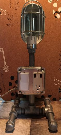 Steampunk Table/ Desk Lamp with dual USB charging station, grounded outlet, and illuminated switch. by RockinRobinsBling