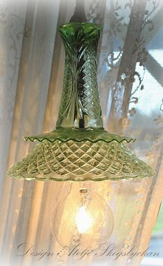 Studio Skogslyckan: Love this light fixture made out of thrifted glassware.