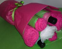 Pamper 'bouquet' includes a hand towel, flannel, body puff & two bottles of bubble bath