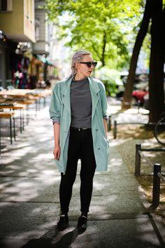 Black pants + striped + teal coat | Spring street style in Berlin [Photo: Kristen Kortebein]