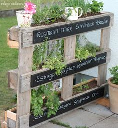 Palette garden. I like the chalk-board idea, too.
