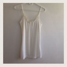 6 white Lacey tanks 4 different styles. Worn and not new but still in great shape.  I have 2 of the first pic and 2 of the second pic and 1 of everything else Old Navy Tops Tank Tops